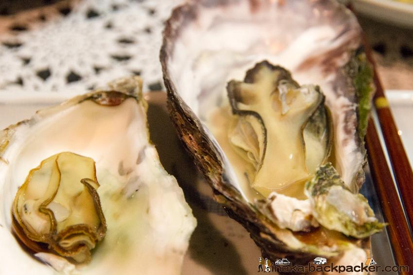 牡蠣 貝殻にお酒をいれて コツ酒