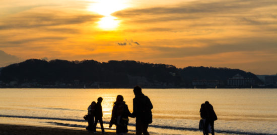 first sunrise hatsuhinode and three girls at yuigahama beach in kamakura
